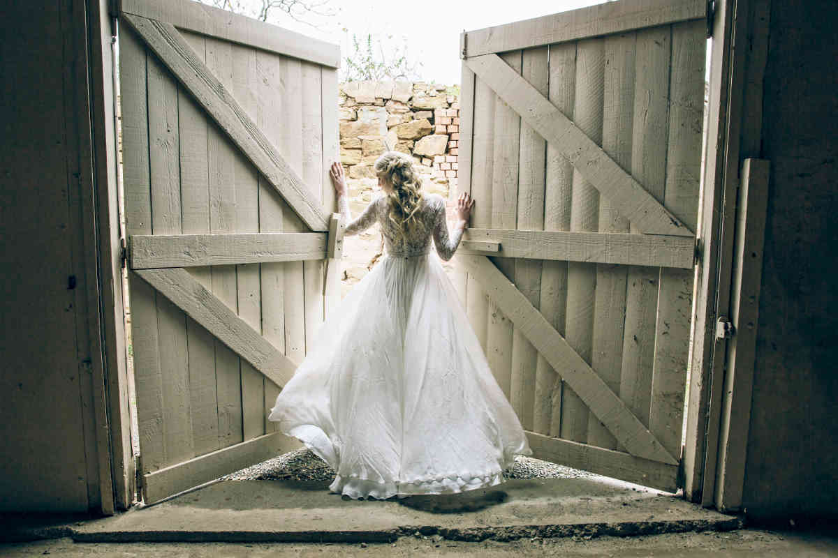 Bride pauses at Anlaby's Stable Doors