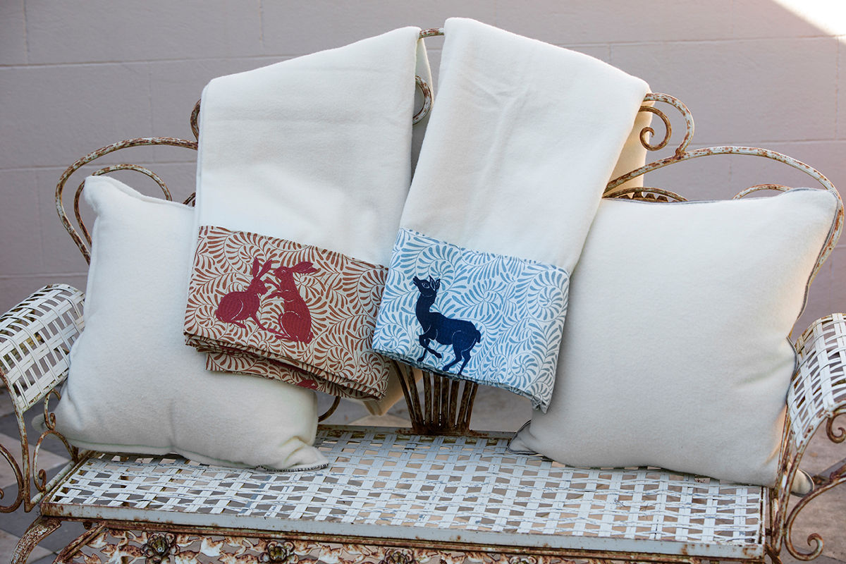 Anlaby Woolen Throws Woodland Friends Blue and Rust on Iron Seat